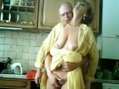 mummy and dad having pleasure in the kitchen.
